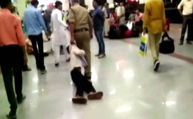 Image result for image of At a busy railway platform in Madhya Pradesh's Gwalior a teen was beaten unconscious by a cop