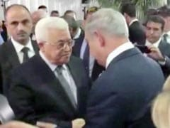 Palestinian President, Israeli Prime Minister Shake Hands At Peres Funeral
