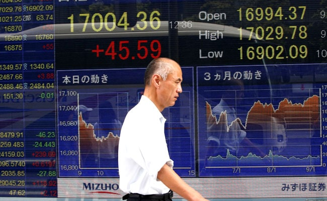 Asia Stocks Gains With Dollar, Sterling Hit By Brexit Woes
