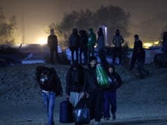 'Jungle' Migrants Given Last Chance To Board Bus Out
