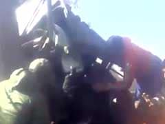 Caught On Camera: Kashmiri Youth Rescue Soldier Trapped Inside Damaged Vehicle