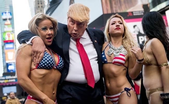 Bikini-Clad Models Surround Fake Donald Trump In New York ...