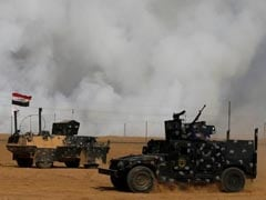 US Troops At Iraq Base Use Protective Masks Over Burning Sulphur