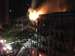 New York City Firefighter Stages Dramatic Rescue In Fatal Blaze
