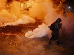 Anti-Trump Protesters March Amid Tear Gas, Flash Grenades