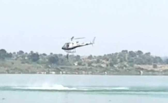 Two Kannada actors missing after jumping into lake from helicopter