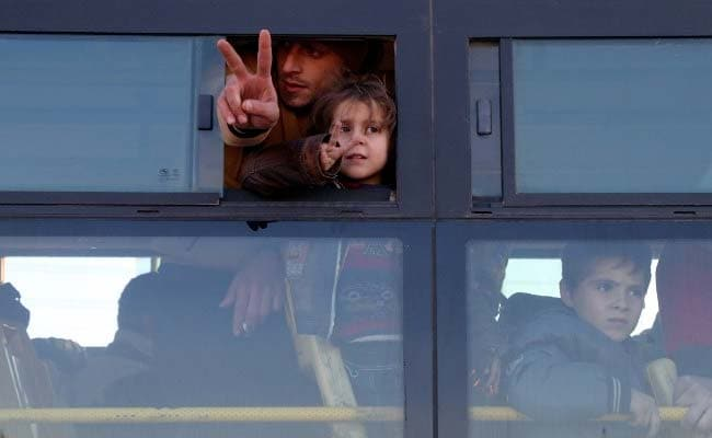 Aleppo buses burned, others readied for evacuees