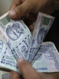 Rupee Trips 11 Paise To 67.87 Against Dollar