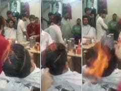 Gulp. Pakistani Stylist Gives Clients Smoking Haircuts Using Fire