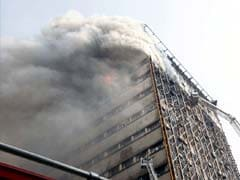 Dozens Of Iran Firefighters Feared Trapped In Building Collapse