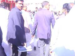 Chief Minister Shivraj Singh Chouhan's Shoes Carried By Security Officer