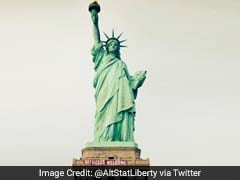 Banner 'Refugees Welcome' Unfurled At Statue Of Liberty