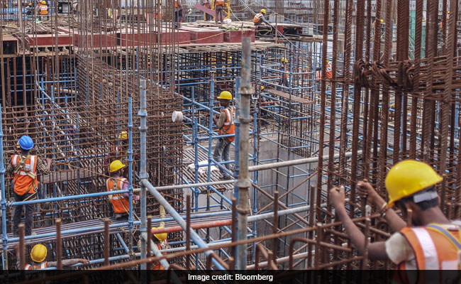 india housing construction bloomberg_650x400_51494303038 affordable housing behind indias plan of housing for all by 2022,How To Plan House Construction In India