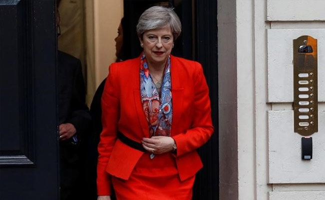 May to head minority government with DUP support