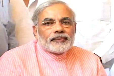Narendra Modi defends 'vote or face action' law