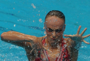 Boudreau-Gagnon keeps solo synchro crown in swimming