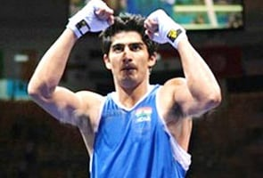 Warnings knock Vijender out of CWG, three Indians in finals