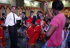 The Obamas charm with their fisherfolk dance