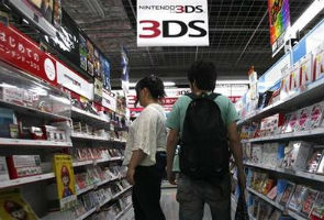 Nintendo posts loss, cuts forecast and 3DS price