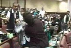 Women Afghan MPs fight, water bottle thrown