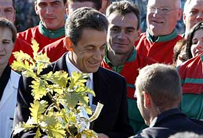 Proud papa Sarkozy says wife, baby 'very well'