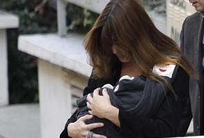 French first lady takes new baby girl home