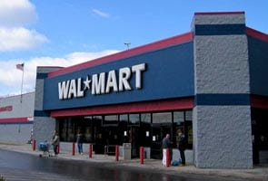 Wal-Mart to pay for medical costs in syringe case