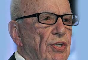 Murdoch staff arrested for bribery, office searched