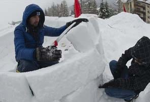 Occupy Wall Steet protesters build igloos in Switzerland to protest economic summit