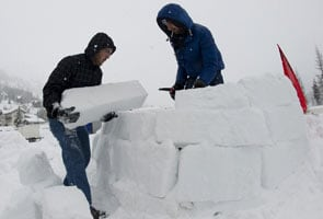 Occupy Davos protesters build igloos
