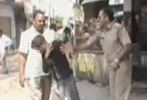 Cops beating teen caught on camera in Andhra Pradesh