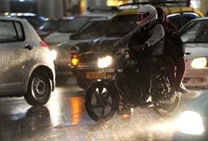 Rains, winds lash Delhi; respite from heat but massive traffic jams