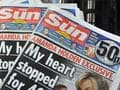 UK phone hacking probe: Sun journalists, police officer arrested for corruption