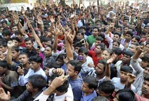 Bangladeshis mourn garment-fire dead, plan protest