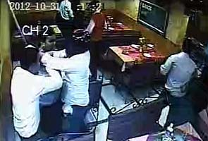 Caught on camera: Men, armed with sticks, vandalise restaurant