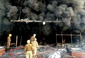 Mob sets shops near Delhi Metro's Karkardooma station on fire