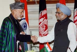 Hamid Karzai meets PM Manmohan Singh, India-Afghan sign four agreements