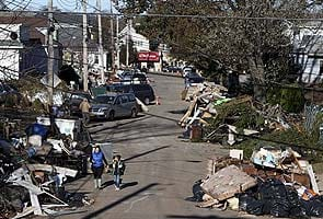 Northeast US cleans up from Superstorm Sandy, death toll rises