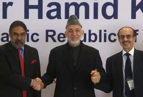 Hamid Karzai beckons India's business leaders to invest