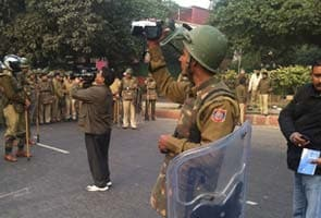 At today's protests in Delhi, cops held video cameras, just in case