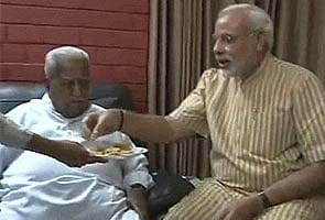 Narendra Modi visits rival Keshubhai Patel, feeds him sweets
