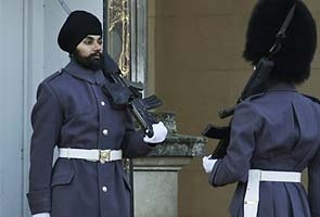 Sikh soldier wears turban on palace guard duty