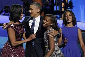 Daughter Malia has cell phone now, gets calls from boys: Obama