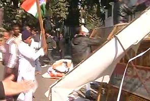 In protests against quota bill, Sonia Gandhi posters ripped in Lucknow