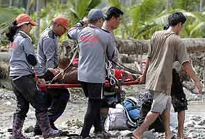 Philippines starts to bury dead as typhoon toll hits 418