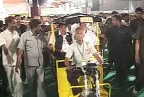 Sharad Pawar shares solar auto rickshaw ride with Nitin Gadkari