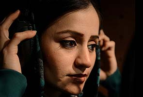 'First' Afghan female rapper seeks reason with rhymes
