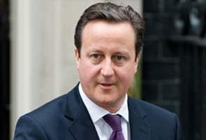 David Cameron makes unannounced visit to Libya