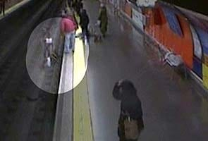 Spain video shows police officer saving woman from tracks