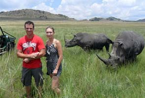 Tourist gored by rhino after wildlife expert asked her to 'stand closer' to the animal for photos